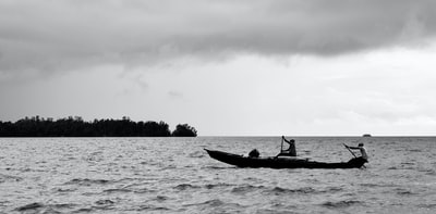 silhouette of men riding a boat cameroon zoom background