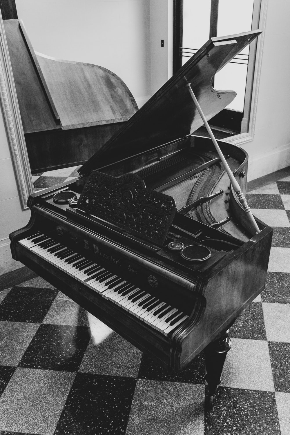 greyscale photo of grand piano