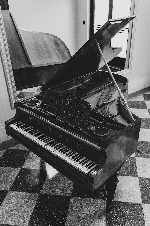 greyscale photo of grand piano