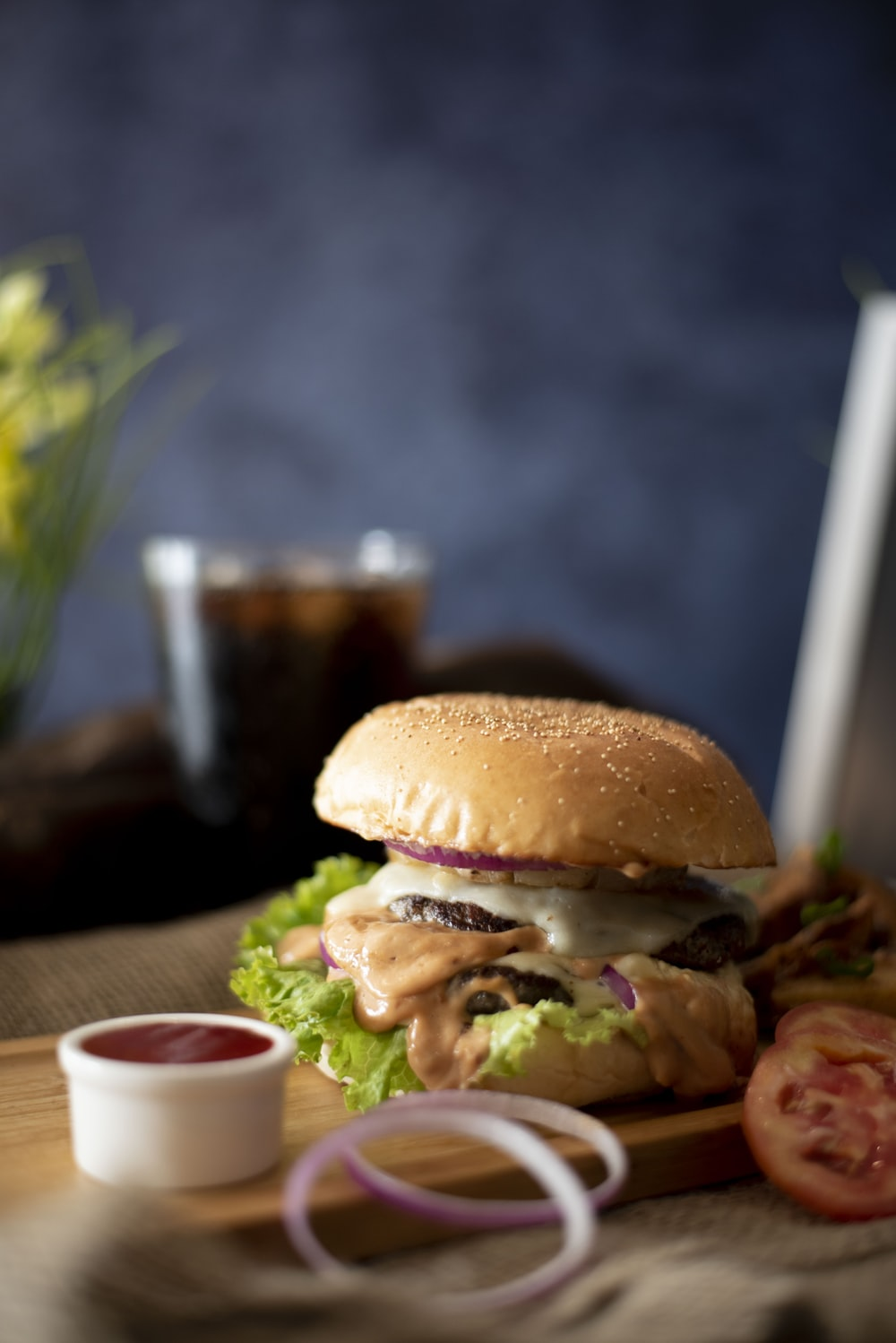 burger dish on brown copping board