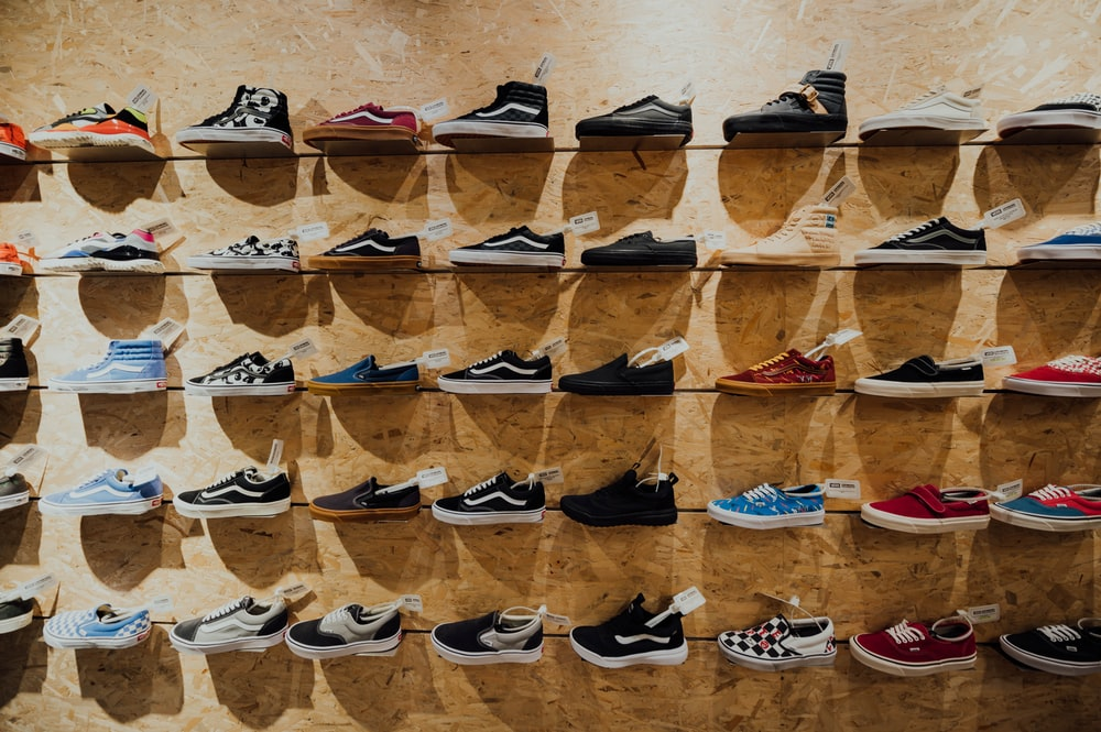 assorted Vans shoes display