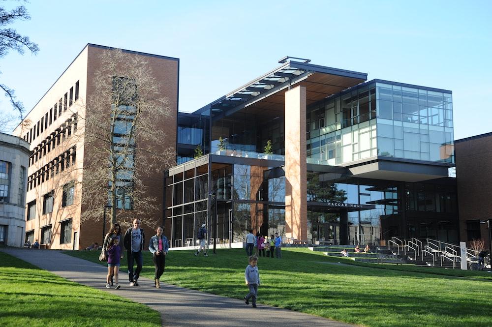 people walking near Paccar Hall University of Washington during daytime