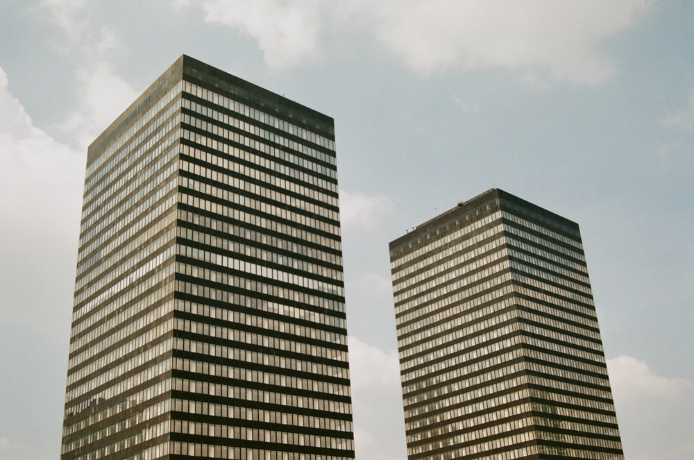 two high-rise buildings under gray sky