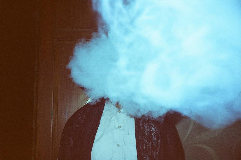 man wearing black jacket smoking photograph