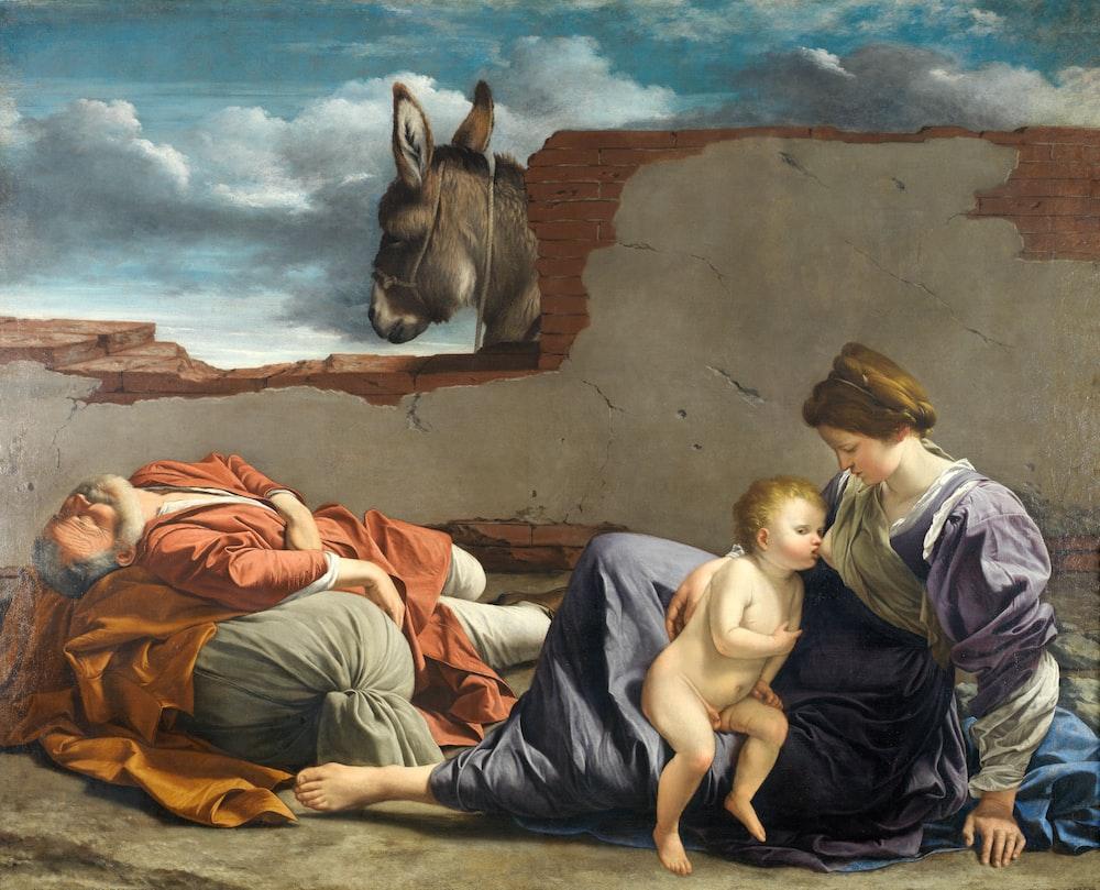 woman breastfeeding toddler painting