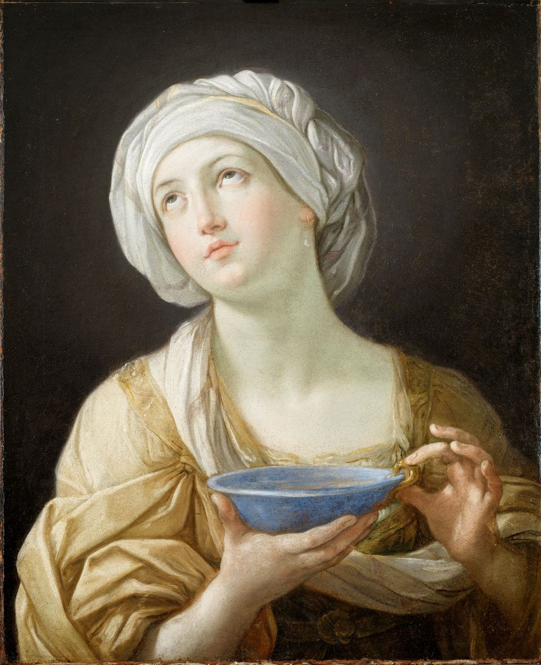 Portrait of a Woman, 1638-39 by Guido Reni. The subject may represent Artemisia II of Caria (d.350 BC) wife of Mausolus, the governor of Caria in Asia Minor. After the death of her husband, she mixed his ashes in liquid which she drank, making herself a living tomb. The story was used as a symbol of a widow's devotion to her husband's memory.