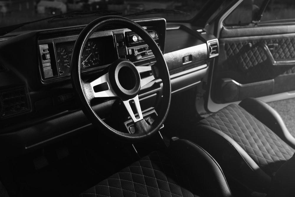 grayscale photo of car dashboard
