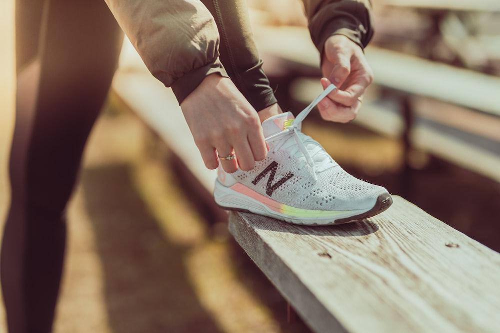 unpaired white and black New Balance running shoe