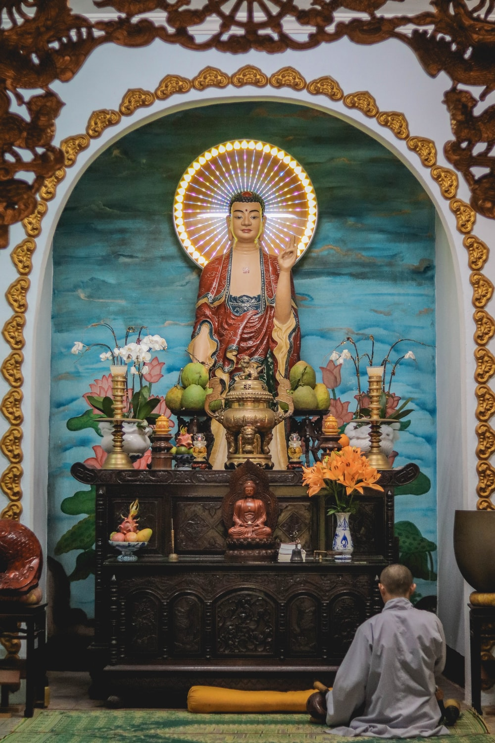 man sitting in front of an altar