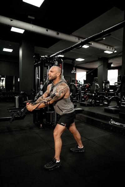 man in gray sleeveless shirt exercising
