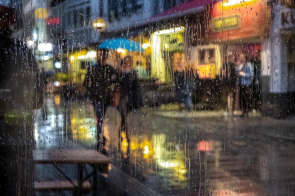 people walking on street in rainy day