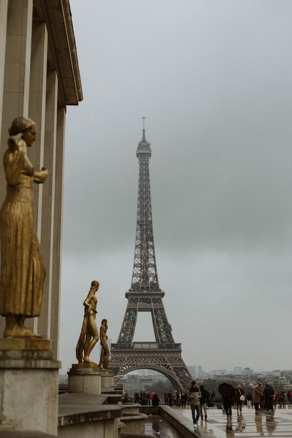 photography of people gathering beside Eiffel Tower during daytime
