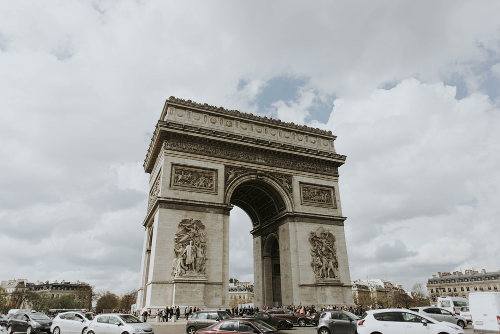 people and cars at Arc de Triomphe Paris, France during day