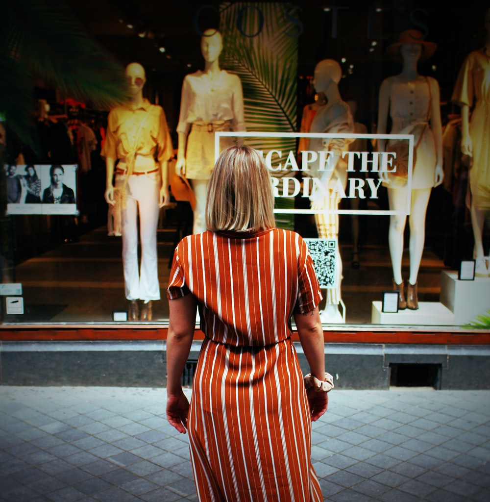 woman in front of clothes store