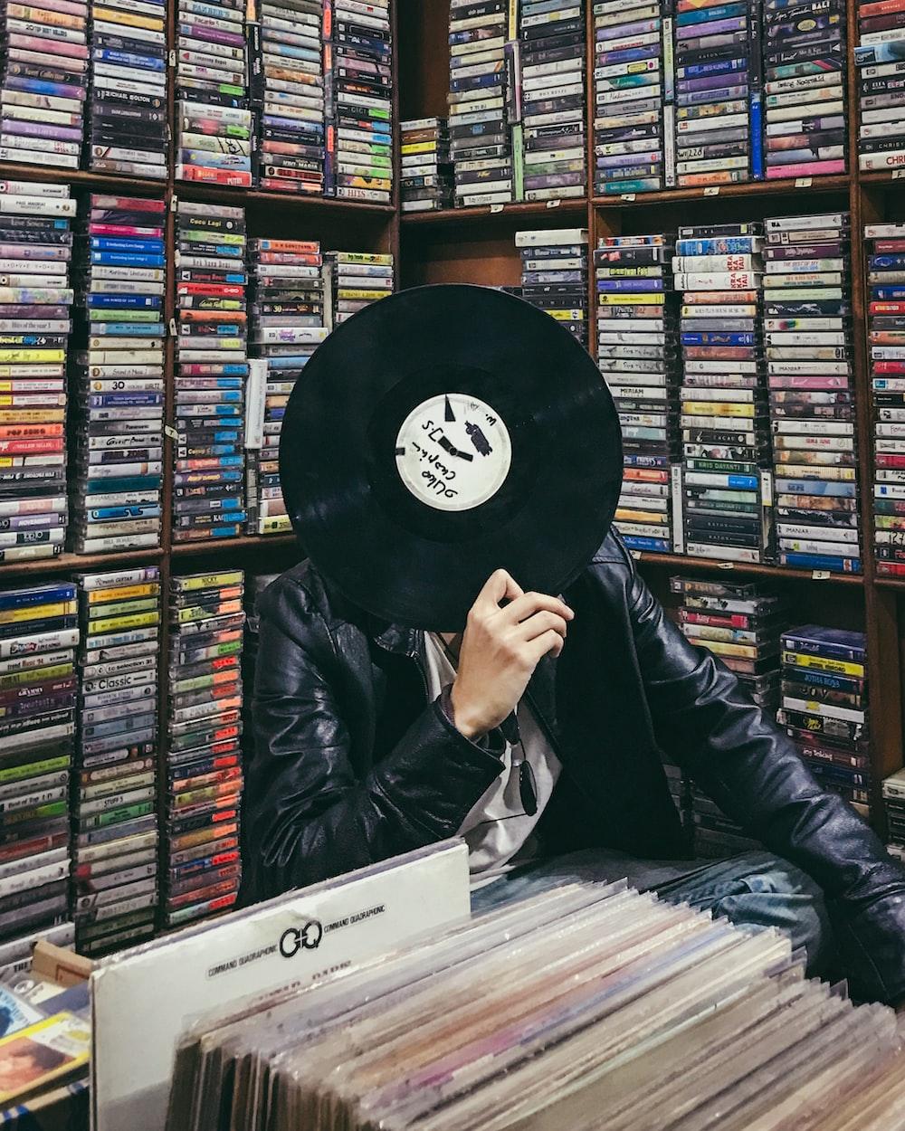 person holding black vinyl disc