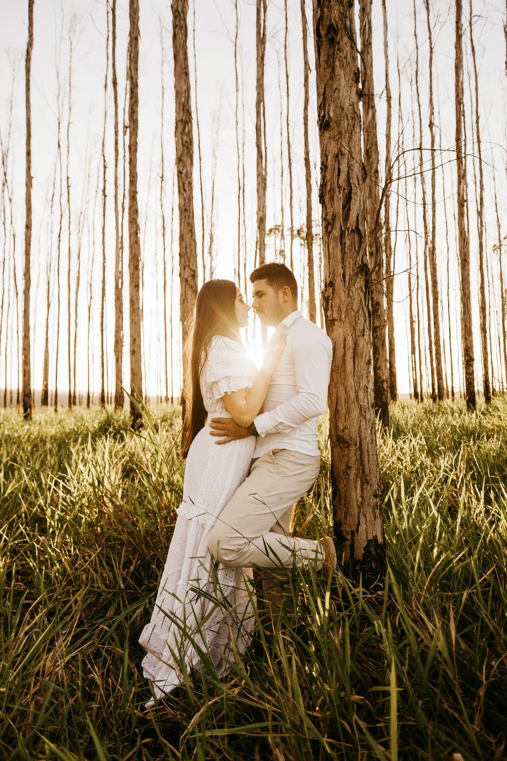 man and woman under trees
