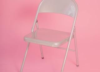 white metal folding chair