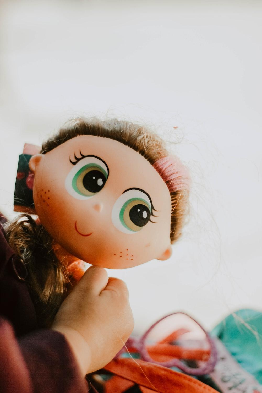 baby holding female doll
