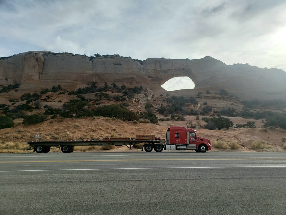 red semi trailer truck on road