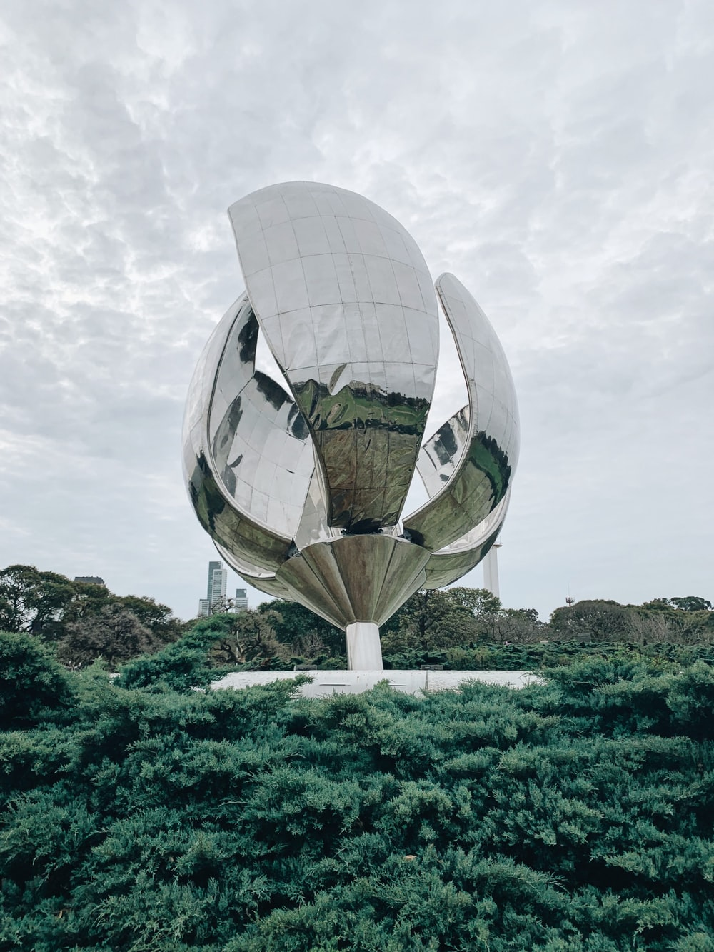 gray metal satellite surrounded with trees