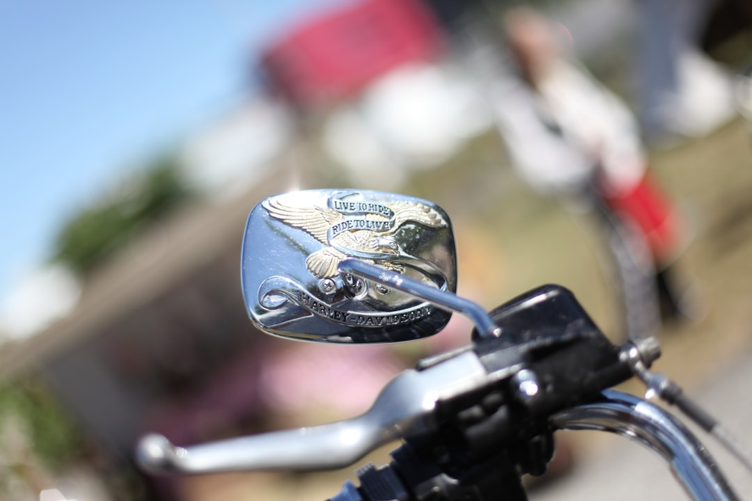 """Harley Davidson rearview mirror, with """"Live to ride, Ride to live"""" motto"""