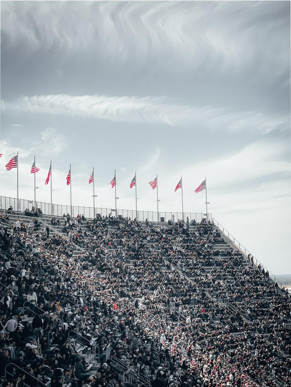 people on stadium during daytime