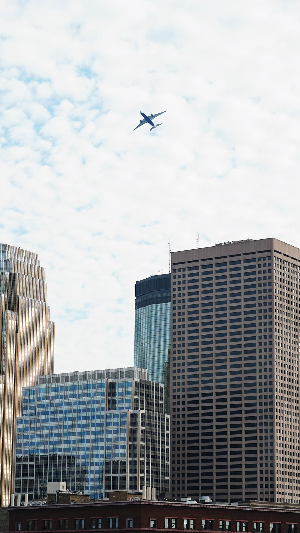 airplane flying above city during day