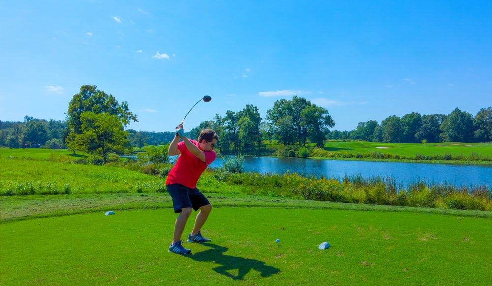 man playing golf photograph