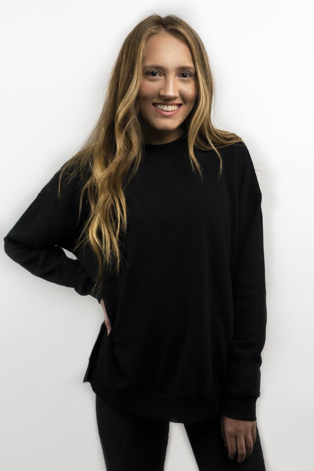 woman wearing black sweater