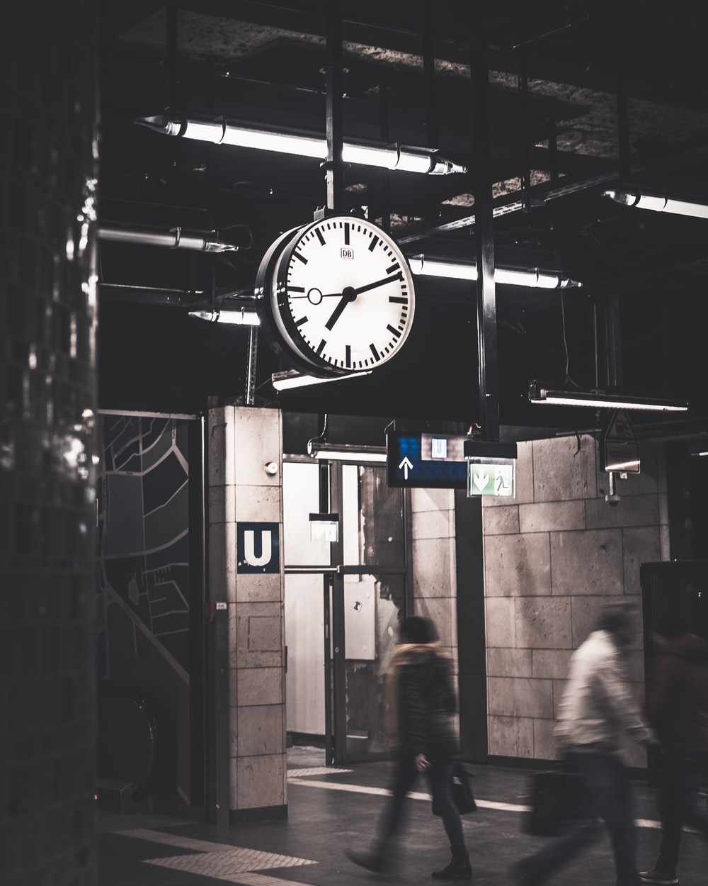 analog hanging ceiling clock displaying 7:11 time
