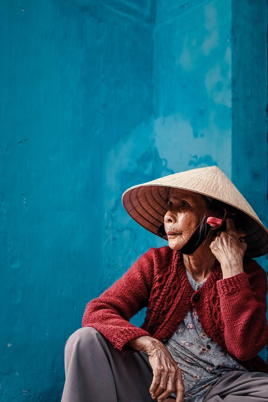 sitting woman wearing farm hat