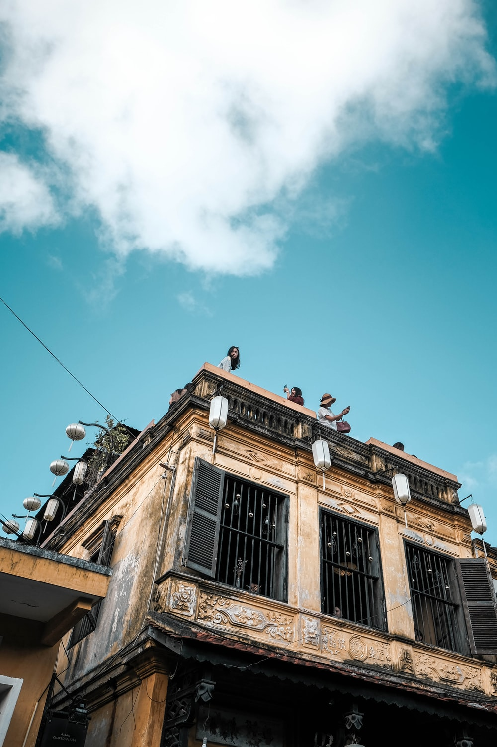 people at the roof of a building during day