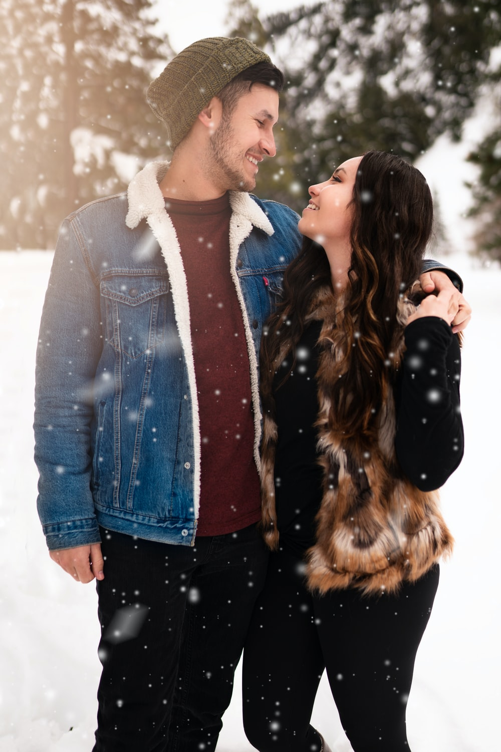 man beside woman facing each other during winter