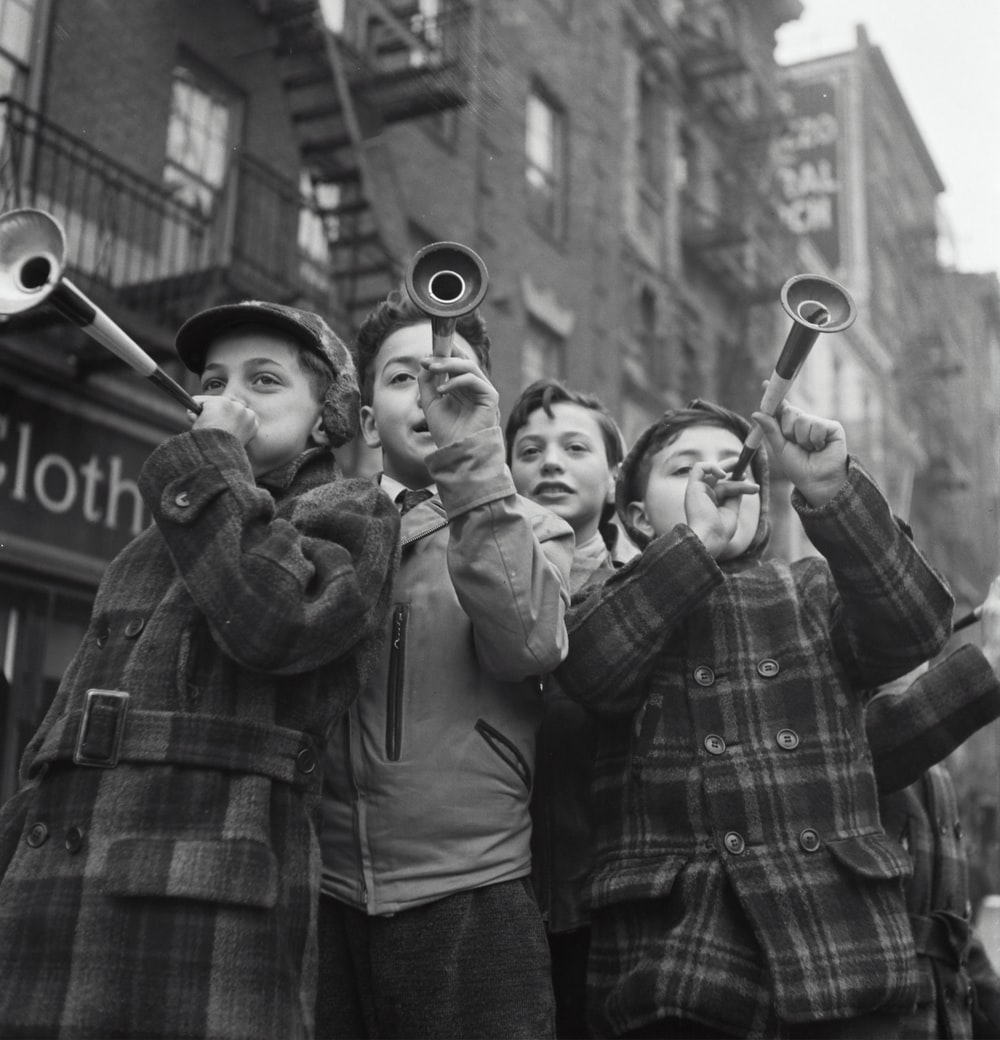 Blowing horns on Bleeker Street on New Year's Day.