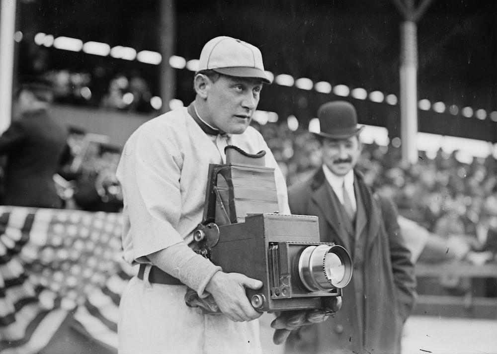 Germany Schaefer, Washington AL (baseball) holding a photographer's camera