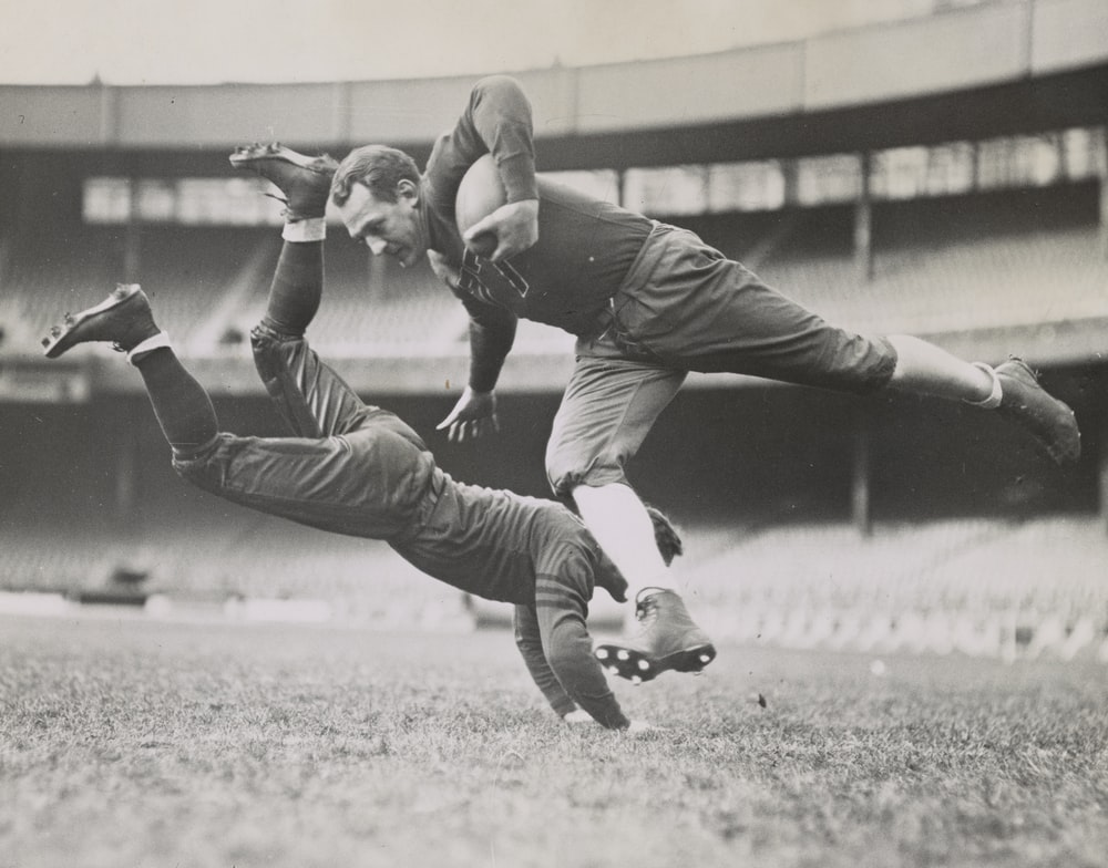 Football players Red Grange and Joe Zeller during practice