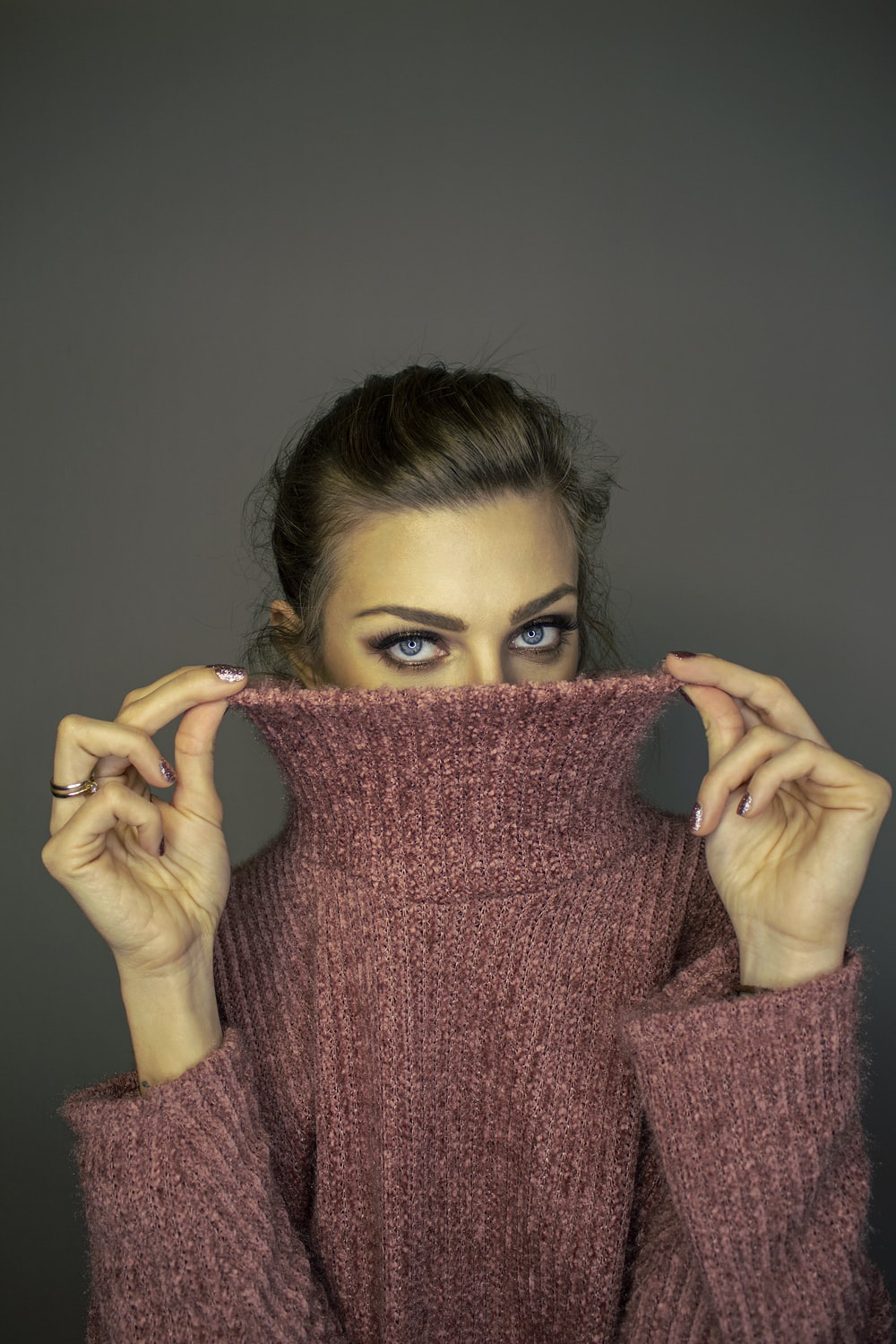 woman in pink turtleneck sweater