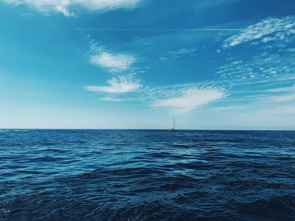 boat floating in the sea during daytime