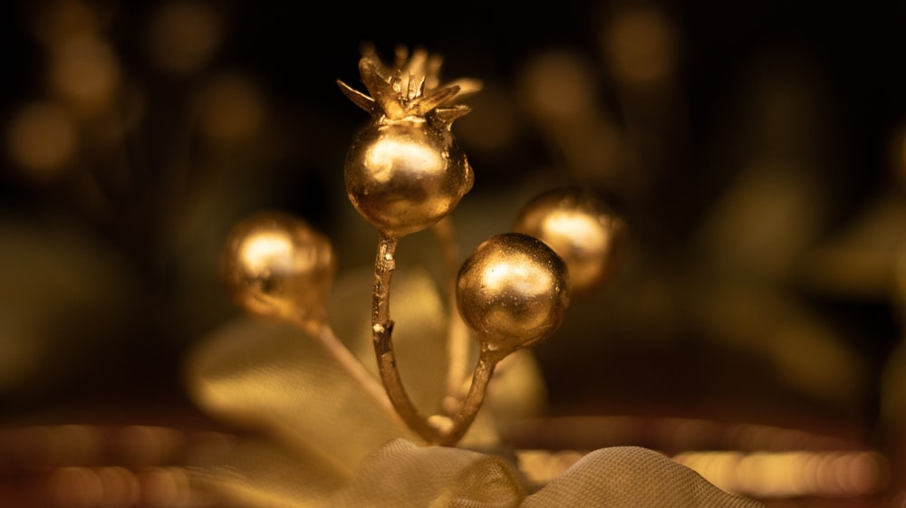 shallow focus photo of gold-colored table ornament