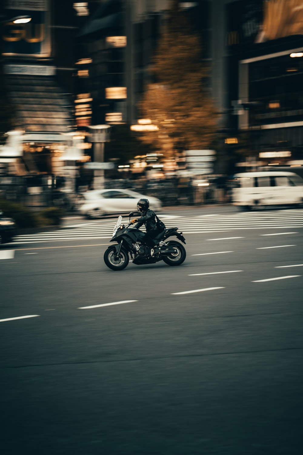 photography of person riding motorcycle