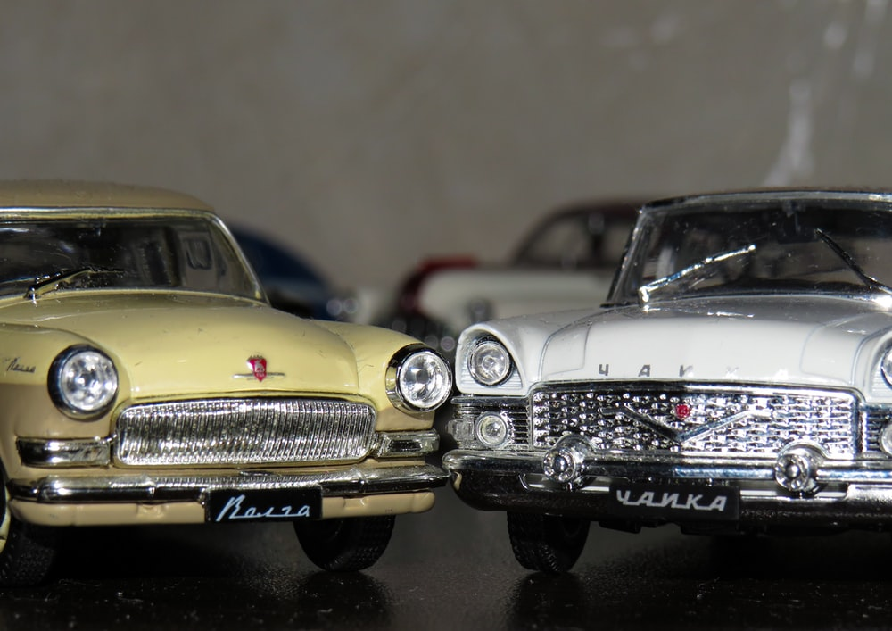 two white and yellow die cast model toy cars