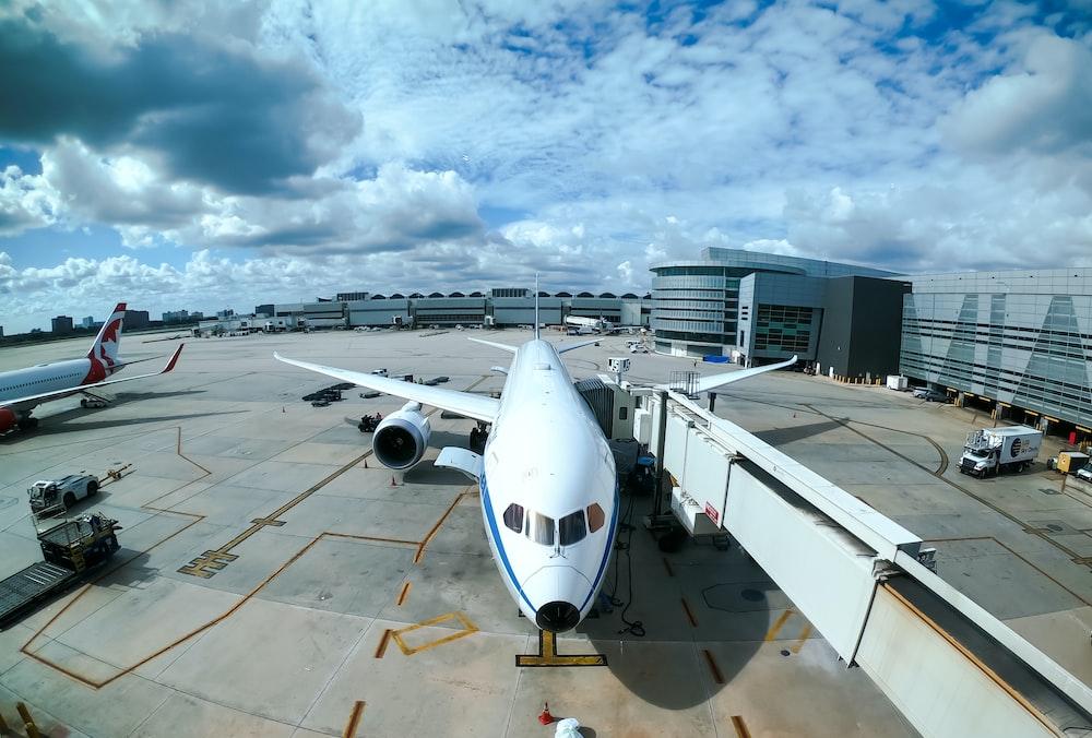 white airplane at airport during daytime