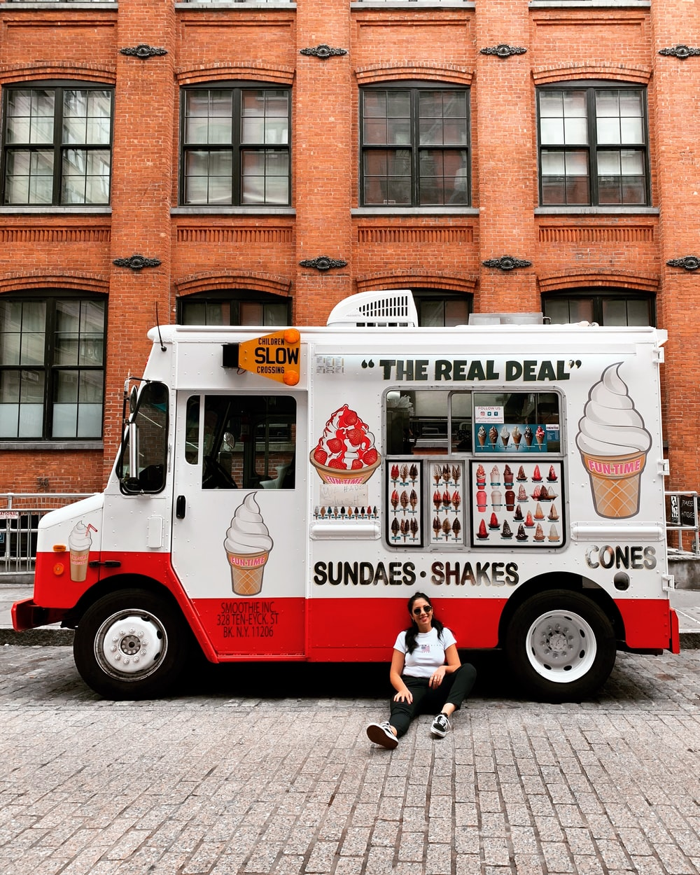 woman leaning on food truck