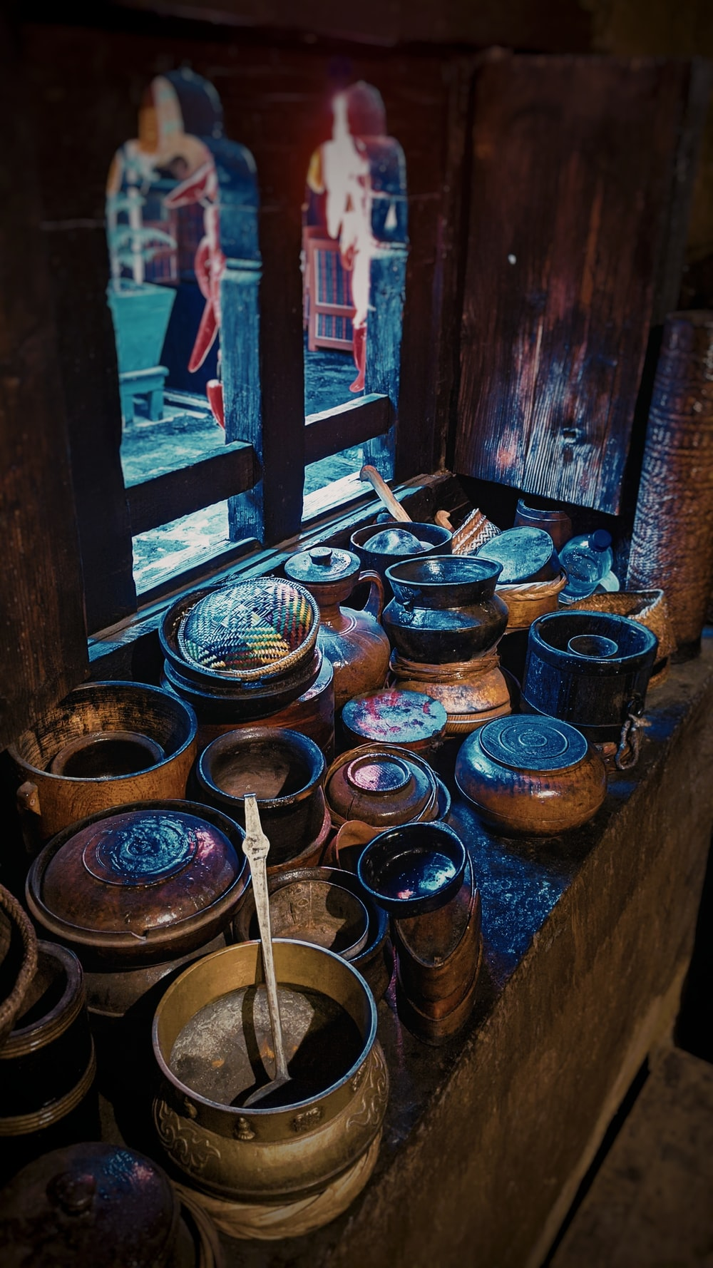 brown pots placed by the window