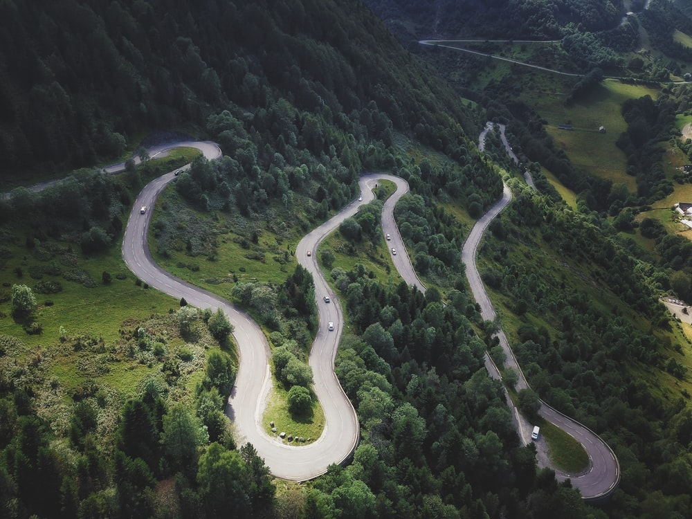 aerial photography of winding road in the mountain