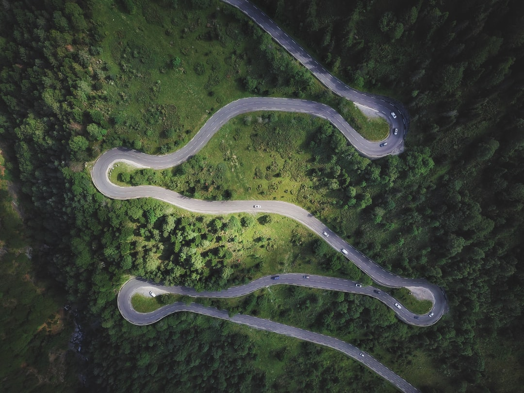 Aerial image of switchback curves climbing up through the French Pyrénées.