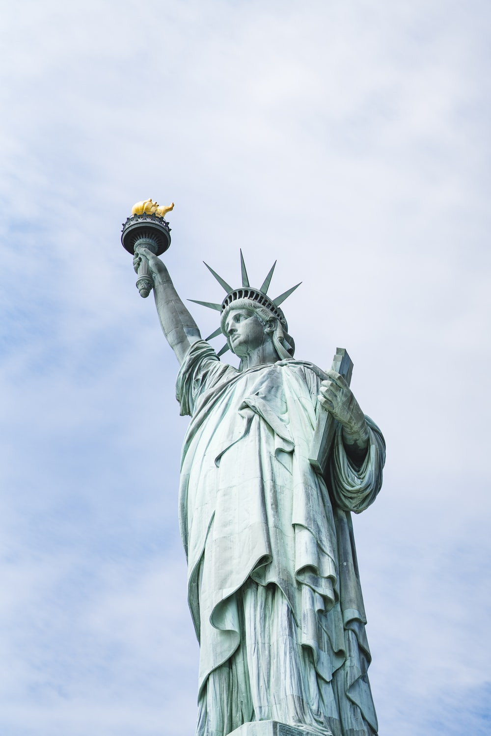 shallow focus photo of Statue of Liberty