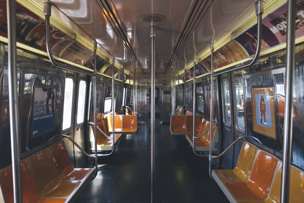 landscape photography of train with empty seats
