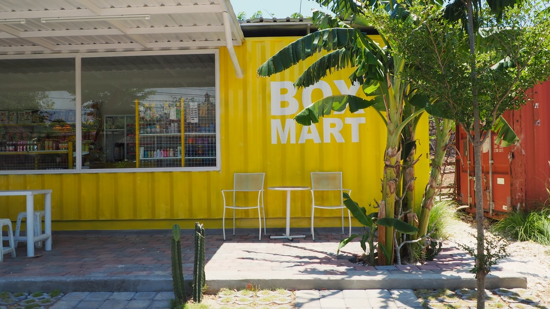 yellow shipping container supermarket