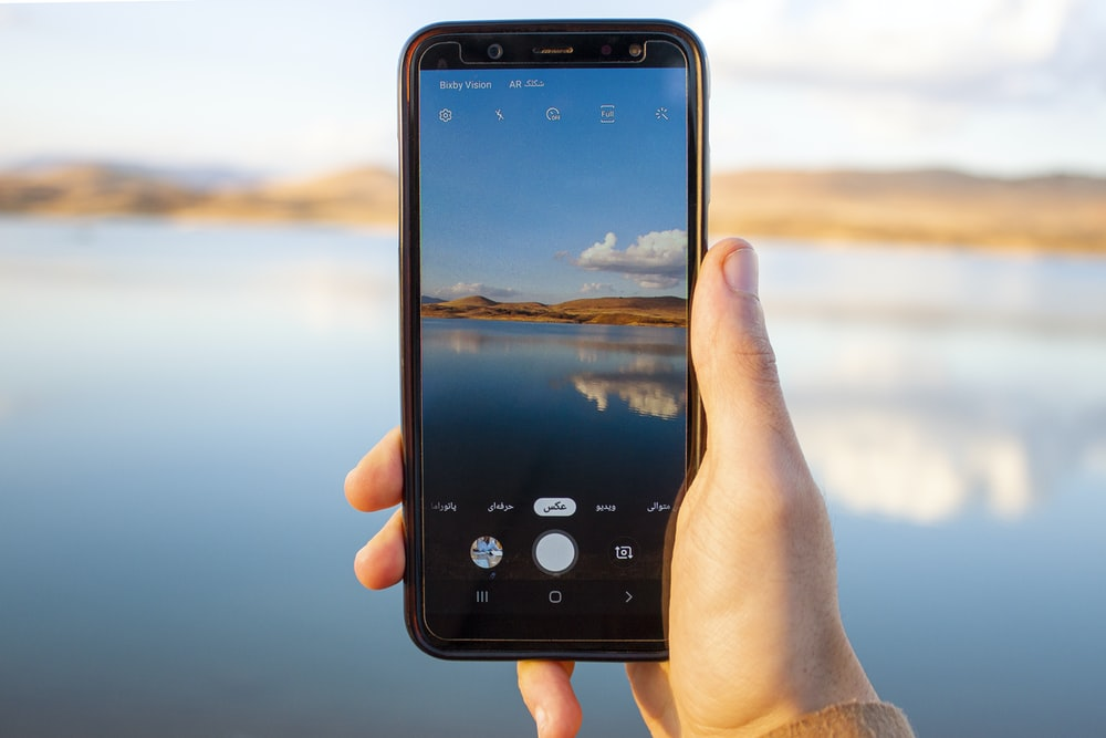 person holding a black smartphone
